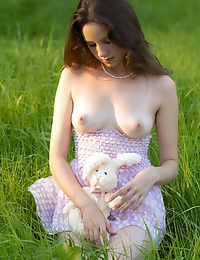 Sweet teen beauty strips in the field exposing her awesome nude body with perfect big tits.
